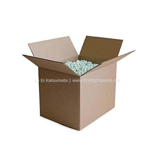 Cardboard shipping box full of styrofoam packing peanuts against a white background