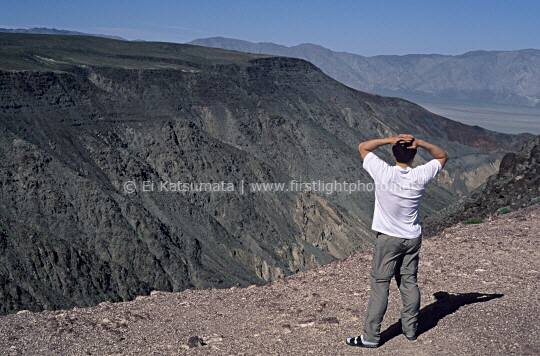 A tourist enjoys the view at Father Crowley Point, Death Valley National Park, California, United States of America