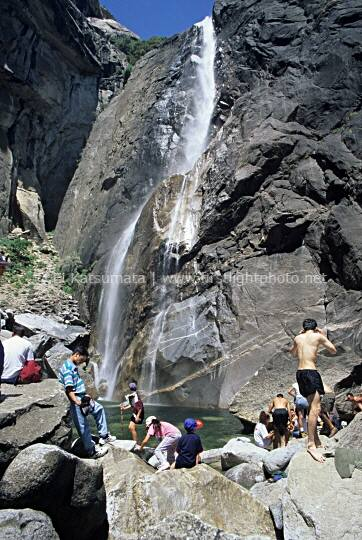 Visitors gather at Lower Yosemite Falls in Yosemite Valley, Yosemite National Park, California, United States of America
