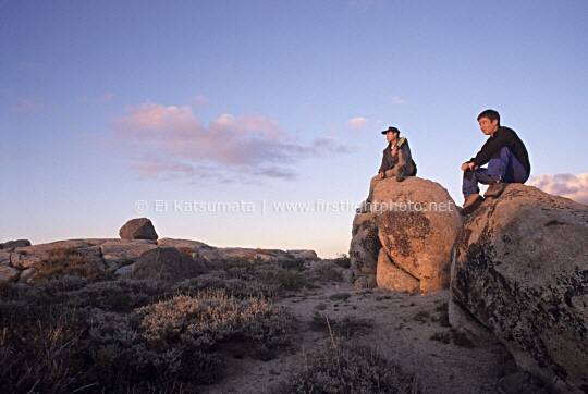 Hikers sitting on top of boulders on the summit of Granite Chief peak in the Granite Chief Wilderness, Tahoe National Forest,  California, United States of America