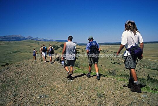 A group of hikers at Pine Butte Swamp Reserve, which is managed by the Nature Conservancy located along the Rocky Mountain Front in Montana. Pine Butte Swamp Reserve is the largest wetland complex along the Rocky Mountain Front and provides important habitat for the grizzly bear in the plains.