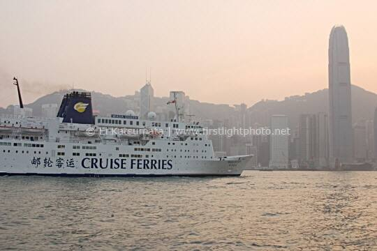 A cruise ship in Victoria Harbour with Hong Kong Island in the background, Hong Kong