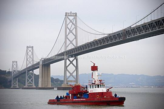 San Francisco Fire Department watercraft with the Bay Bridge in the background