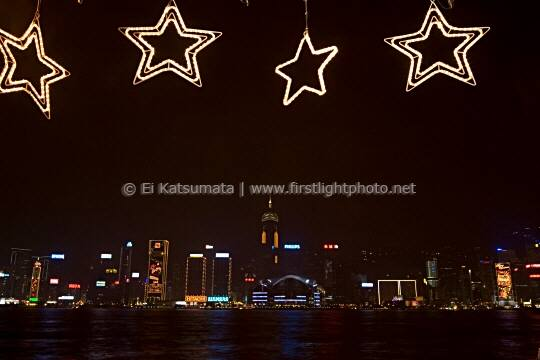 Hong Kong skyline at night as seen from the Avenue of the Stars in Tsim Sha Tsui, Kowloon, Hong Kong, China, Asia