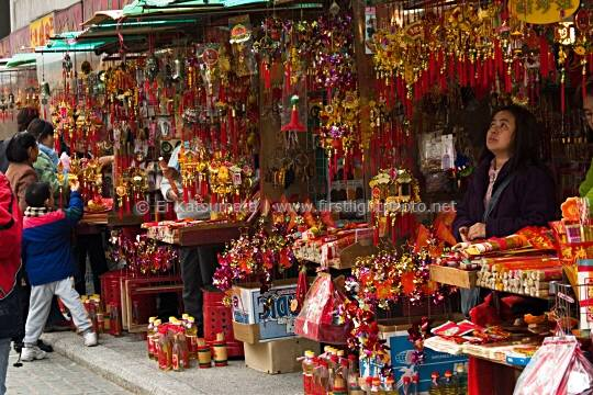Street vendors selling incense and other religious goods and offerings at Sik Sik Yuen Wong Tai Sin Temple in Kowloon, Hong Kong, China, Asia