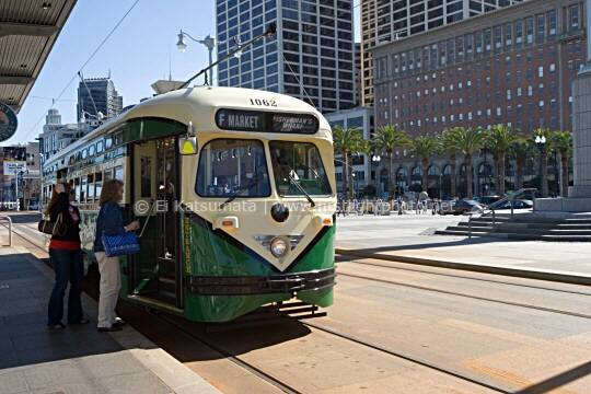 Passengers board one of San Francisco Municipal Railway's historic streetcars F Market line at the Ferry Building along the Embarcadero waterfront, San Francisco, California, United States of America