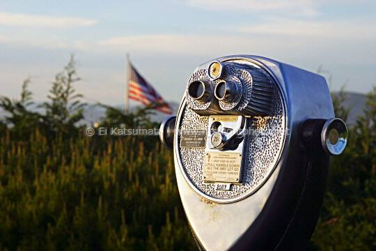 Coin operated binocular with US flag in the background at Coit Tower on Telegraph Hill, San Francisco, California