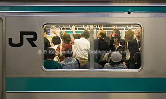 JR train during the rush hour commute at Shinjuku Station, Tokyo, Japan