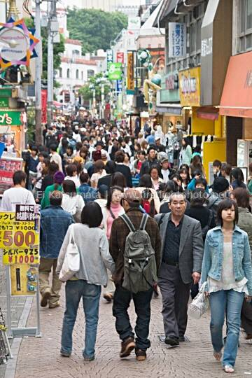 Shoppers crowd the streets along Takeshita dori in the Harajuku district, Shibuya Ward, Tokyo, Japan