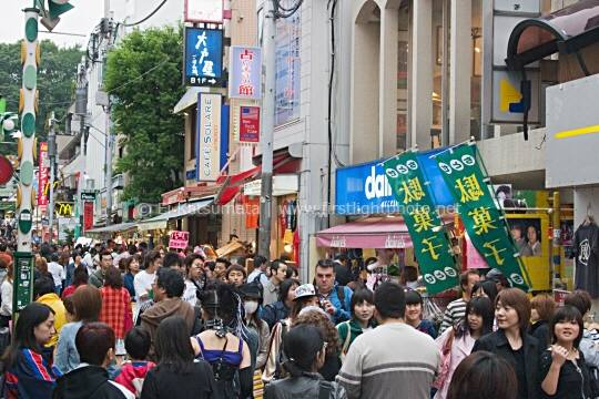 Shoppers crowd the street along Takeshita dori in Harajuku, Shibuya Ward, Tokyo, Japan