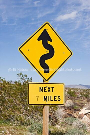 Road sign indicating curves ahead on Highway 190 in Death Valley National Park, California, United States of America