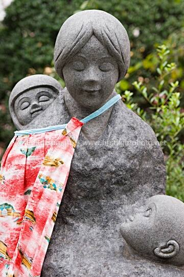 A statue of a mother wtih two children at Sensoji (aka Asakusa Kannon Temple), Tokyo, Japan